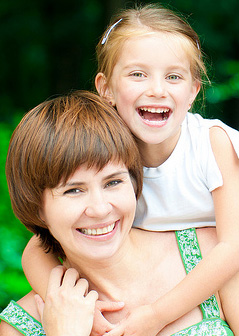 Woman and daughter smiling